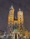 St. Mary gothic church facade at night in Krakow, Poland Stock Photo