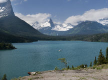 St Mary Lake with white tourist boat Royalty Free Stock Image