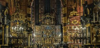 St. Mary`s Basilica. Krakow. Interior of the St. Mary`s Basilica. The largest Gothic altarpiece in the World - The Altarpiece of Veit Stoss polish Wit Stwosz in Stock Photos