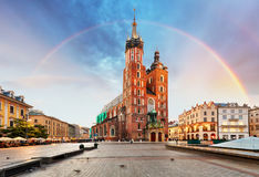 St. Mary`s basilica in main square of Krakow with rainbow.  Royalty Free Stock Photography
