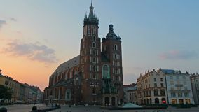 St. Mary`s Basilica in old Krakow, evening time lapse stock footage