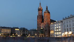 St. Mary`s Basilica in old Krakow, evening time lapse stock video footage