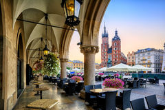 St Mary`s Basilica and Sukiennice in Krakow, Poland. St Mary`s Basilica and Sukiennice on Main Market Square in Krakow, Poland, on sunrise royalty free stock photo