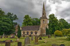 St Mary's Church in Cotswolds, Lowe. St Mary's Church with graveyard in Cotswolds, Lower Slaughter, UK Royalty Free Stock Image