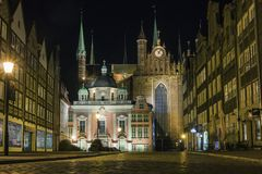 St. Mary`s Church and King`s Chapel in the Old Town in Gdansk at night. Poland stock images