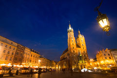 St. Mary's Church on Rynek Glowny (Market Square) in night time. Royalty Free Stock Images