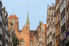 St. Mary`s Church and Street in Gdansk. View of St. Mary`s Church and old buildings on the St. Mary`s Street ul. Mariacka  at the Main Town Old Town in Gdansk Stock Photo