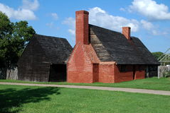 St. Mary's City, MD: Van Sweringen's Inn. Late 17th century Van Sweringen's Inn with its steeply pitched wooden roof has been faithfully reconstructed at stock photo