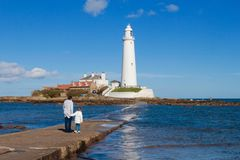 St Mary`s Lighthouse and causeway Stock Photo