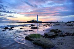 St Mary's Lighthouse and Gree. St Mary's Lighthouse on the coast of North Tyneside, North East England. It is connected to the Mainland by a tidal causeway Stock Images