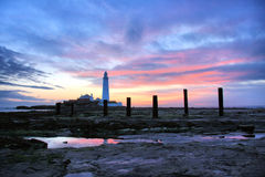 St Mary's Lighthouse and Posts. St Mary's Lighthouse on the coast of North Tyneside, North East England. It is connected to the Mainland by a tidal causeway Royalty Free Stock Images