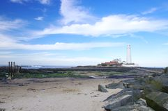 St Mary's Lighthouse with Rocks Stock Photo