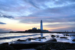 St Mary's Lighthouse and Sea. St Mary's Lighthouse on the coast of North Tyneside, North East England. It is connected to the Mainland by a tidal causeway Stock Images