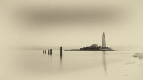 St Mary's Lighthouse. Lighthouse in Sepia at St Mary's Whitley Bay UK Stock Photo