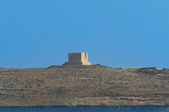 St Mary`s Tower - fortification on the island of Comino, Malta. St Mary`s Tower - fortification on the island of Comino, European island state of Malta stock photo
