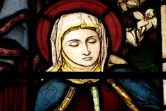 St. Mary in stained glass. A stained glass window of St. Mary royalty free stock image