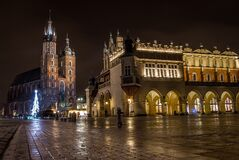 St Mary's Basilica (Kościół Mariacki) and Sukiennice, Krakow, Poland Royalty Free Stock Photography