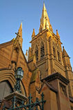 St. Marys Cathedral in Sydney. Top part lighted with sun, tower detail Stock Photo