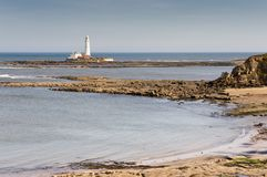 St Marys Lighthouse across sandy bay Stock Image
