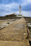 St marys lighthouse causeway whitley bay uk. St marys lighthouse in whitley bay on the northeast coast of england, first operational in 1898 and decomissioned Royalty Free Stock Images