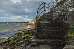 St Marys Lighthouse from Old Hartley steps. Stock Photos