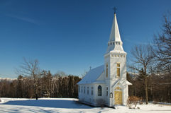 St. Matthew's Chapel. A quaint, New England style chapel in Sugar Hill, NH in the winter Royalty Free Stock Images