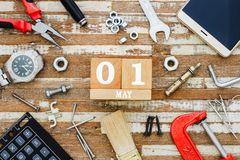 1st May. Happy International Worker's day or Labour Day background concpet.  wooden block calendar 1 May and handy tools and stock image