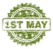 Scratched Textured 1ST MAY Stamp Seal. 1ST MAY stamp seal watermark with rubber print style. Green rubber print of 1ST MAY title with retro texture stock illustration