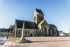 St Mere Eglise. The famous church with the manequin of solder on the tower bell in St Mere Eglise in Normandy Royalty Free Stock Photo