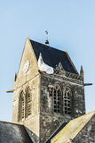 St Mere Eglise. The famous church with the manequin of solder on the tower bell in St Mere Eglise in Normandy Stock Photos