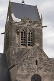 St. Mere Eglise, Normandy, France. Hanging doll of american paratrooper from the Church of Sainte-Mere-Eglise in Normandy, France stock photos