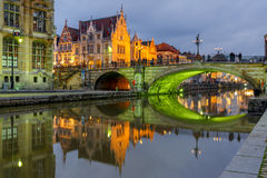 St Michael Bridge with green light, Ghent, Belgium. Picturesque medieval building and St. Michael's Bridge with an unusual green illumination in the evening in stock photography