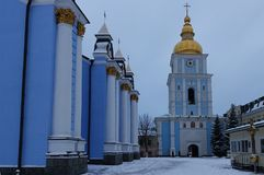 St. Michael Golden-domed Cathedral and bell tower in Kiev. On a winter day Stock Images