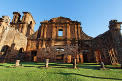 St Michael of the Missions Cathedral. The imposing facade of Saint Michael of the Missions jesuit catholic cathedral ruins with its orange stones and single Royalty Free Stock Photo