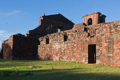 St Michael of the Missions Cathedral. The ruins of Saint Michael of the Missions jesuit catholic cathedral with its orange stones side wall Royalty Free Stock Photography