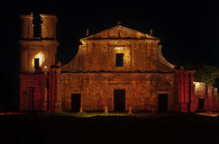 St Michael of the Missions Cathedral. Saint Michael of the Missions jesuit catholic cathedral ruins facade with its orange stones and single tower lighten at Royalty Free Stock Photo