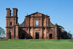 St Michael of the Missions Cathedral. Saint Michael of the Missions jesuit catholic cathedral ruins facade with its orange stones and single tower Stock Images