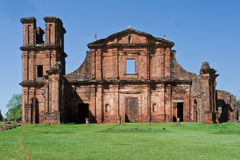St Michael of the Missions Cathedral. The facade of Saint Michael of the Missions jesuit catholic cathedral ruins facade with its single tower and orange stones Stock Photo
