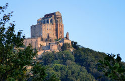 St. Michael's Abbey, Italy. St. Michael Abbey, Sacra di San Michele, Italy - General view in a clear day with blue sky Stock Photos