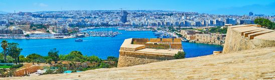 The view from Valletta bastions, Malta. St Michael`s Bastion of Valletta fortress is the perfect place to observe the curved coast of Ta`Xbiex, Gzira and Manoel stock photo