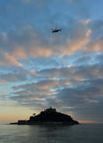 St Michael`s Mount Castle Island Sunset with helicopter in Cornwall Royalty Free Stock Photo