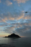 St Michael`s Mount Castle Island Sunset with helicopter in Cornwall Royalty Free Stock Photography