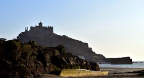 St Michael's Mount Castle Shadow. St Michael's Mount island durring sunset Royalty Free Stock Images