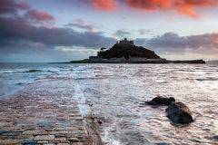 St Michael's Mount in Cornwall. Sunset at the causeway at high tide leading to St Michaels Mount at Marazion near Penzance in Cornwall Royalty Free Stock Photo