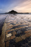 St. Michael's Mount. The receding tide exposes the causeway to St. Michael's Mount, one of Cornwall's iconic landmarks Royalty Free Stock Photography