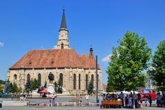 St. Michael`s Roman Catholic Church and Matthias Corvinus monument in Cluj-Napoca Royalty Free Stock Photography