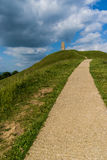 St Michael's Tower, Glastonbury. Looking up the path towards St Michael's Tower at the top of Glastonbury Tor Royalty Free Stock Photo