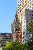 St Michael Uniting Church Melbourne. MELBOURNE, AUSTRALIA - MARCH 21, 2015: St Michael's Uniting Church tower with modern building, famous landmark of Melbourne royalty free stock photo