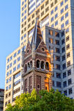 St Michael Uniting Church Melbourne. St Michael's Uniting Church tower with modern building, famous landmark of Melbourne on the Collins and Russel Streets stock images
