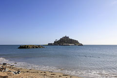 St Michaels Mount Cornwall England. St Michaels Mount from the beach at Marizion Cornwall England isolated by the high tide Royalty Free Stock Photo